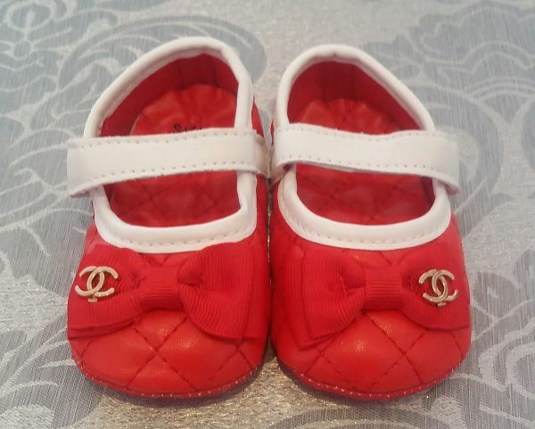 Red and white baby shoes
