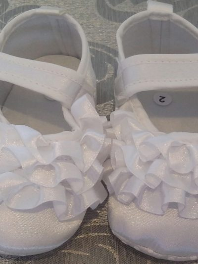 White baby shoes with frill